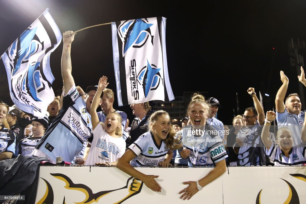 Sharks fans celebrate a try during the round one NRL match between the Cronulla Sharks and the Brisbane Broncos at Southern Cross Group Stadium on March 2, 2017 in Sydney, Australia.
