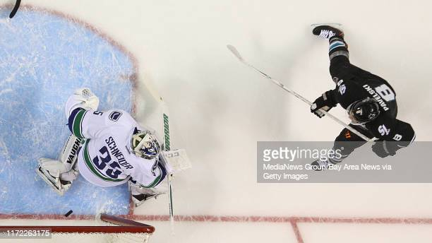 Sharks forward Joe Pavelski scores on Vancouver goaltender Cory Schneider in the first period of Game 3 of an NHL hockey Stanley Cup playoff...
