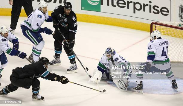 Sharks forward TJ Galiardi puts a shot on Vancouver goaltender Cory Schneider in the first period of Game 3 of an NHL hockey Stanley Cup playoff...