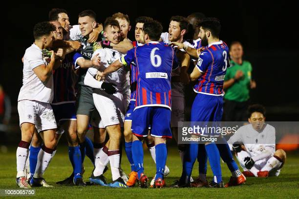 Sharks goalkeeper Matthew SYMES gets Jordan MURRAY of the Tigers in a headlock as a melee take place during the FFA Cup round of 32 match between...