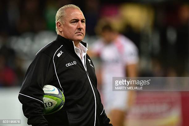 Sharks head coach Gary Gold watches his team warmup during the Super Rugby match between New Zealand's Otago Highlanders and South Africa's Coastal...