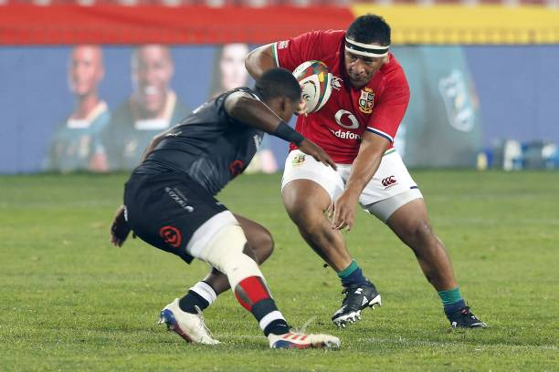 Sharks' hooker Fez Mbatha (L) tackles British and Irish Lions' prop Mako Vunipola (R) during a rugby union tour match between the Sharks against the British and Irish Lions at the Ellis Park stadium in Johannesburg on July 7, 2021. (Photo by Phill Magakoe / AFP) (Photo by PHILL MAGAKOE/AFP via Getty Images)