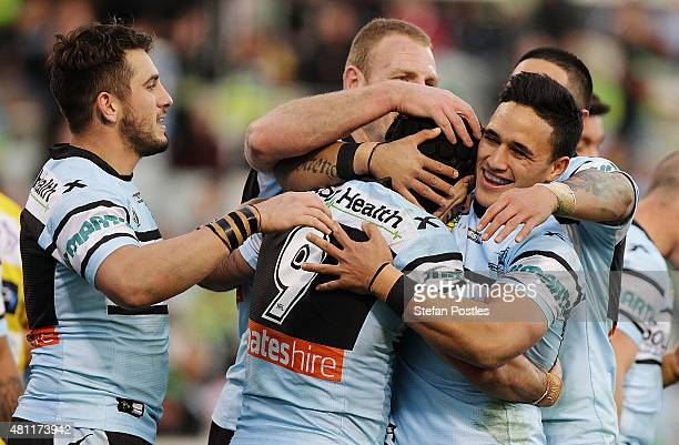 Sharks players celebrate during the round 19 NRL match between the Canberra Raiders and the Cronulla Sharks at GIO Stadium on July 18 2015 in...