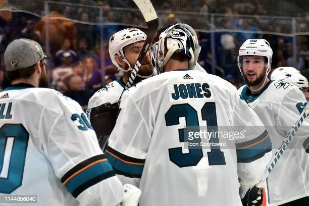Sharks players congratulate San Jose Sharks goaltender Martin Jones after winning a NHL Stanley Cup Playoffs Western Conference Final game three...
