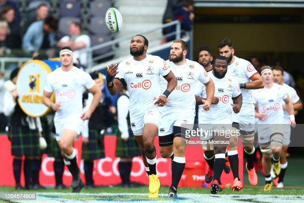 Sharks players run onto the field during the round 2 Super Rugby match between the Highlanders and the Sharks at Forsyth Barr Stadium on February 07,...