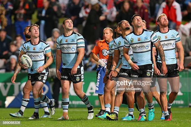 Sharks players watch a conversion attempt during the round 23 NRL match between the St George Illawarra Dragons and the Cronulla Sharks at WIN...