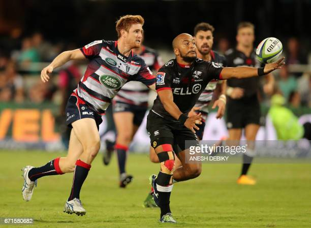 Sharks Rhyno Smith is tackled by Rebels Nic Stirzaker during the Super XV rugby union match between Sharks and Rebels at Kingspark rugby stadium on...