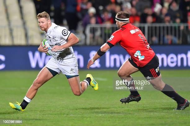 Shark's Robert du Preez runs the ball next to Crusaders' Scott Barrett during the Super Rugby quarterfinal match between the New Zealand's Canterbury...