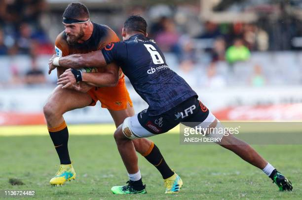 Sharks' South African flanker Luke Stringer fights for the ball with Jaguares' Argentinian flanker Marcos Kremer during the Super Rugby match between...
