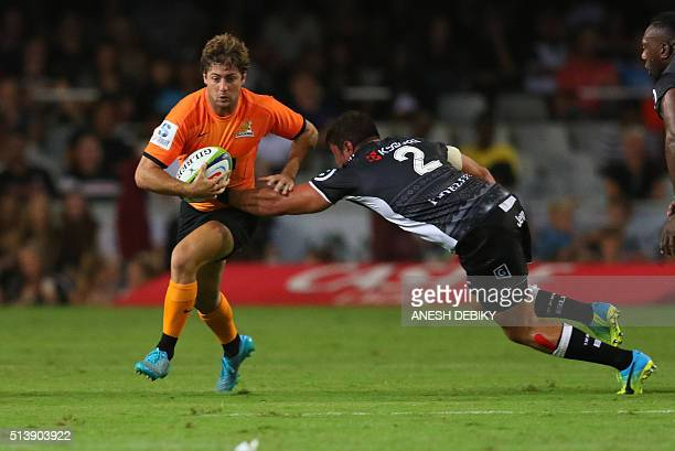 Sharks' South African Franco Marais tackles Jaguares' Argentinian Santiago Cordero during the Super Rugby match between Sharks and Jaguares on March...