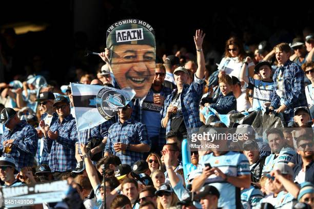 Sharks supporters cheer during the NRL Elimination Final match between the Cronulla Sharks and the North Queensland Cowboys at Allianz Stadium on...