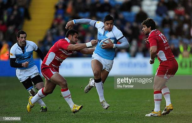 Sharks wing Luther Burrell makes a break during the Amlin Challenge Cup match between Sale Sharks and Agen at Edgeley Park on December 18 2011 in...