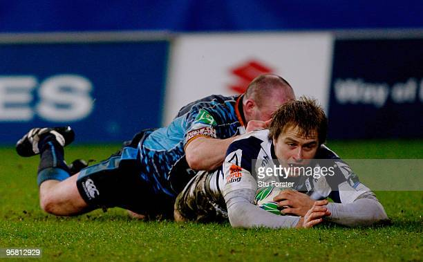 Sharks winger Matthew Tait dives over to score during the Heineken Cup Pool 5 Round 5 match between Cardiff Blues and Sale Sharks at Cardiff City...