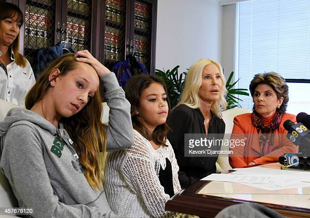 Sharla Fisher mother of Roxy Fisher speaks with attorney Gloria Allred Nancy Beals mother of Kayla Beals looking on during a news conference...