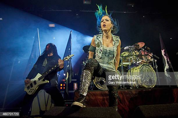 Sharlee D'Angelo and Alissa WhiteGluz of Arch Enemy performs on stage at Manchester Academy on December 19 2014 in Manchester United Kingdom