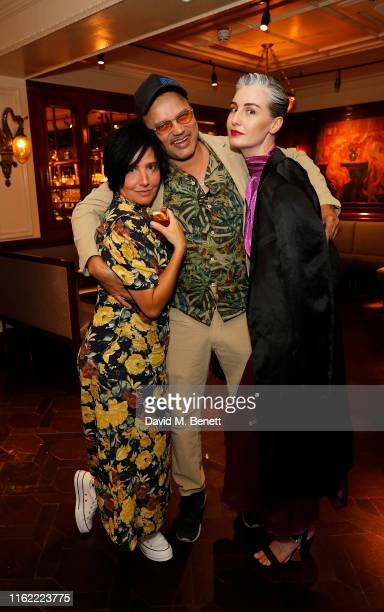 Sharleen Spiteri Gerry DeVeaux and Erin O'Connor attend the #MOVINGLOVE dinner hosted by Felicity Jones Derek Blasberg Katie Grand at Bellanger on...