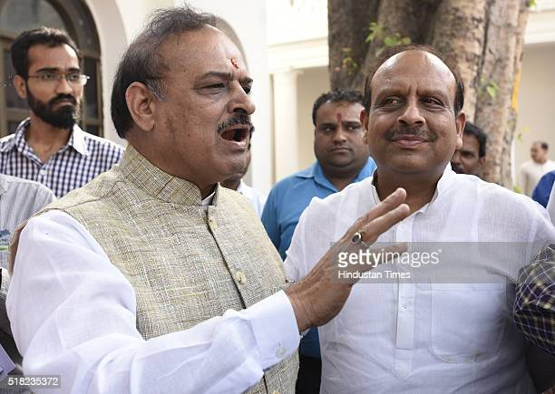 Sharma with Vijender Gupta leader of opposition in Delhi Assembly during the Delhi Assembly Budget Session at Delhi Vidhan Sabha on March 30 2016 in...