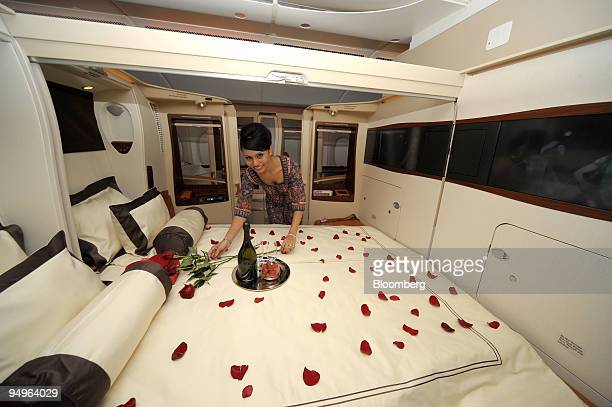 Sharmala Huey Yuen a Singapore Airlines Ltd flight steward prepares the double bed in the luxury class suite during a media tour of the new A380...