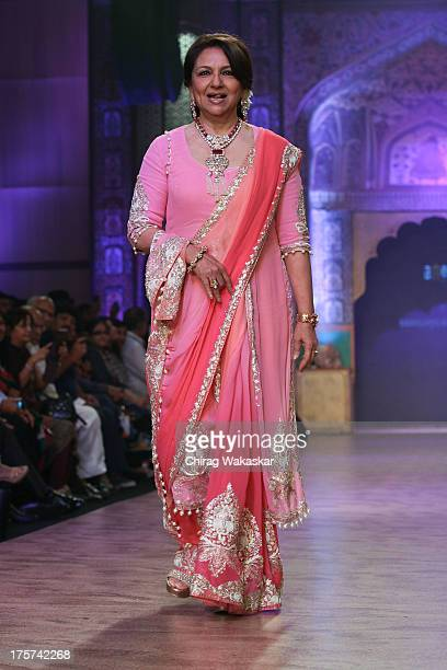 Sharmila Tagore walks the runway at the Birdhichand Ghanshyamds Jewellers show on day 4 of India International Jewellery Week 2013 at the Hotel Grand...