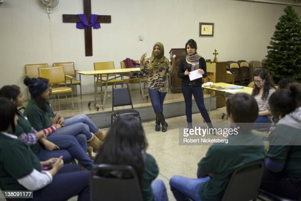 Sharmin Hossain center and Denise Romero right give a counter military recruitment workshop December 14 2011 to high school students in Harlem New...