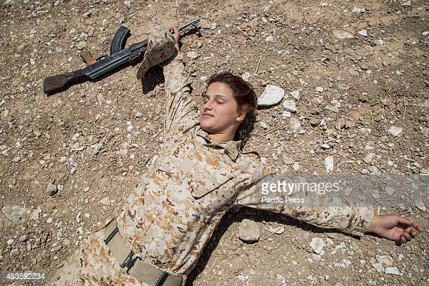 Sharmin Omar of the 2nd Battalion 24 years old and 4 months pregnant plays dead during a military exercise She is mother of a 5 years old girl and...