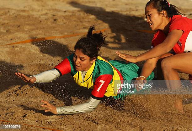 Sharmin Rima of Bangladesh dives for the line as she competes in the Beach Kabaddi event at North Al Hail during day eight of the 2nd Asian Beach...