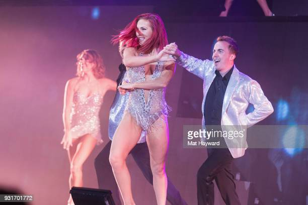 Sharna Burgess and Frankie Muniz perform on stage during Dancing With The Stars Live at WaMu Theater on March 13 2018 in Seattle Washington