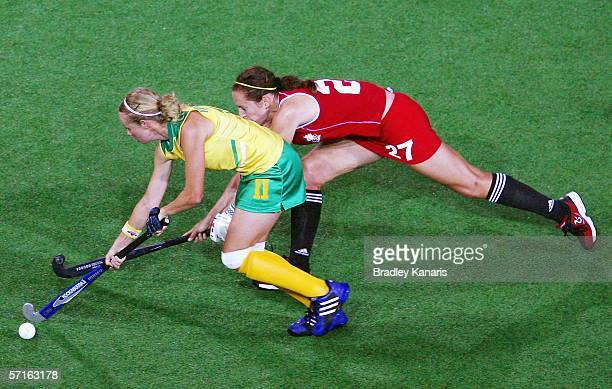 Sharne Wehmeyer of South Africa is challenged by Margaret Linton of Canada during the hockey match between South Africa and Canada at the State...