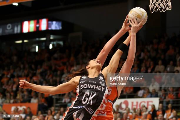 Sharni Layton of the Magpies and Kristina Brice of the Giants compete for the ball during the Super Netball Major Semi Final match between the Giants...