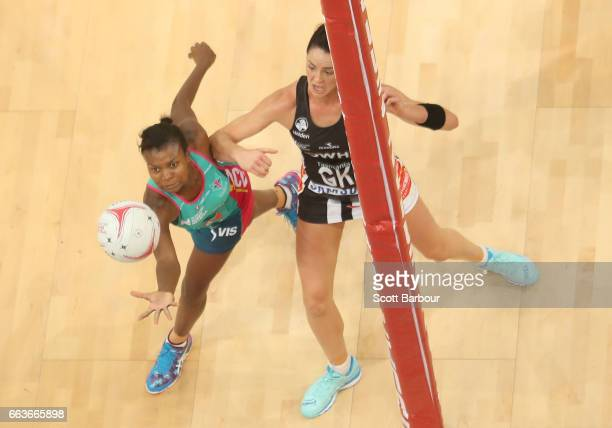 Sharni Layton of the Magpies and Mwayi Kumwenda of the Vixens compete for the ball during the round seven Super Netball match between the Magpies and...