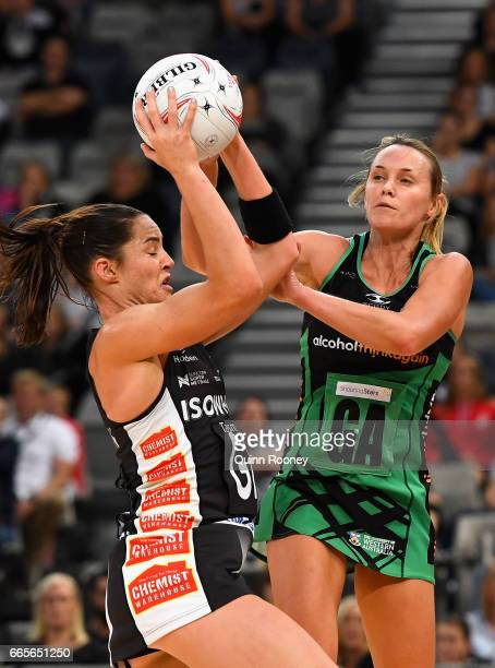 Sharni Layton of the Magpies and Natalie Medhurst of the Fever compete for the ball during the round eight Super Netball match between the Magpies...