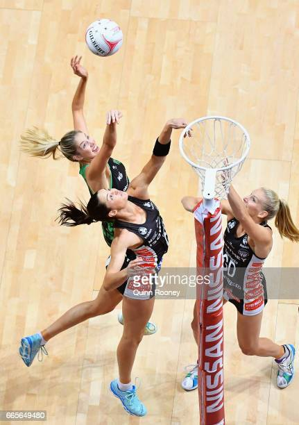 Sharni Layton of the Magpies attempts to block a shot by Kaylia Stanton of the Fever during the round eight Super Netball match between the Magpies...