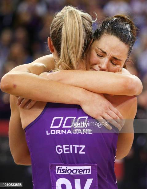 Sharni Layton of the Magpies hugs Laura Geitz of the Firebirds after her final match before retirement during the round 14 Super Netball match...