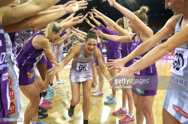 Sharni Layton of the Magpies is given a guard of honor at the end of her final game before retirement after the round 14 Super Netball match between...