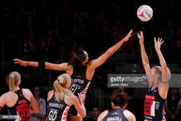 Sharni Layton of the Magpies jumps as Erin Bell of the Thunderbirds shoots during the round 14 Super Netball match between the Thunderbirds and...