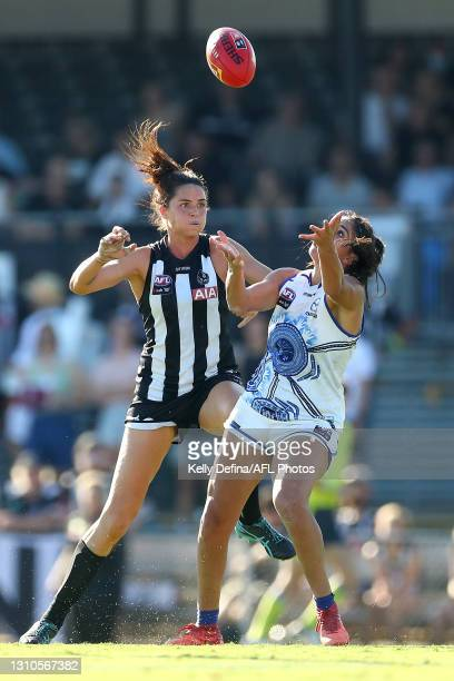 Sharni Norder of the Magpies and Vivien Saad of the Kangaroos compete for the ball during the AFLW Finals Series match between the Collingwood...