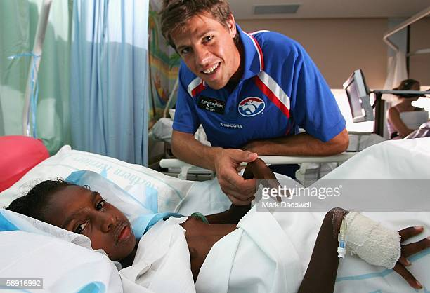 Sharni Warlapinni from Melville Island who is a patient in the Royal Darwin Hospital is visited by Ryan Hargrave of the Bulldogs during the Western...