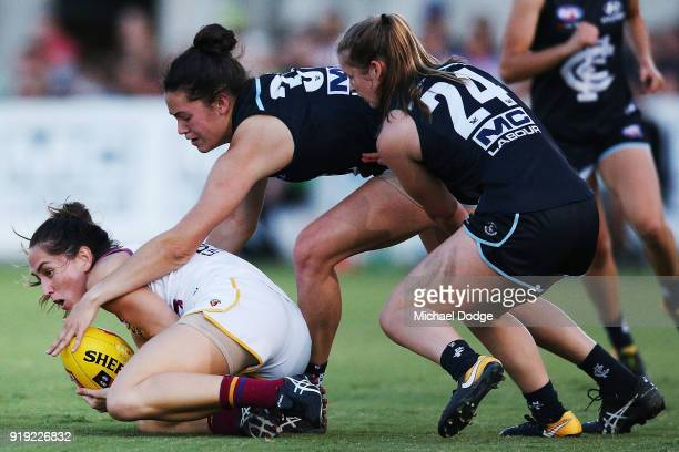 Sharni Webb of the Lions dives on th ball ahead of Danielle Hardiman of the Blues during the round three AFLW match between the Carlton Blues and the...