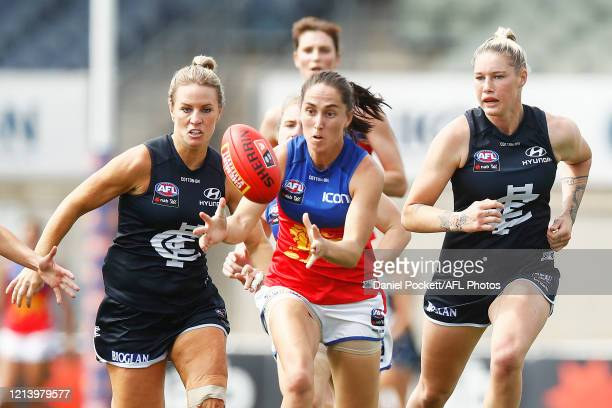 Sharni Webb of the Lions gathers the ball during the AFLW Semi Final match between the Carlton Blues and the Brisbane Lions at Ikon Park on March 22...