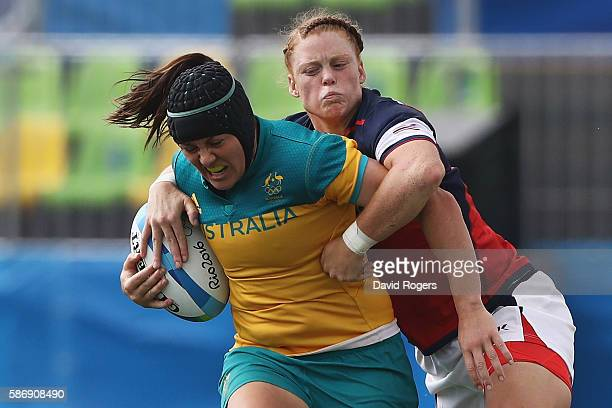 Sharni Williams of Australia carries the ball under pressure against Alev Kelter of the United States during the Women's Pool A rugby match on Day 2...
