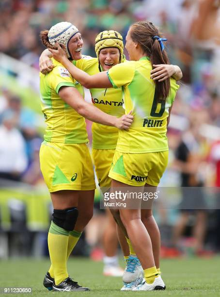 Sharni Williams, Shannon Parry and Evania Pelite of Australia celebrate victory at the end of final match against New Zealand during day three of the...