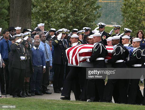 Sharon Blair looks on as a US Navy Honor Guard carries the casket of Navy MasteratArms 2nd Class Mark Mayo during a burial service at Arlington...