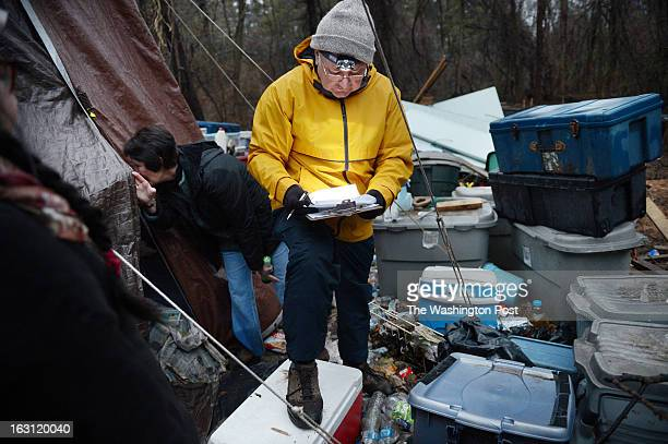 Sharon Bulova Chairman of the Fairfax County Board of Supervisors left peeks in a tent to talk to a homeless man as volunteer Court Gifford center...
