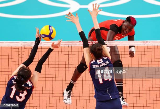 Sharon Chepchumba Kiprono of Team Kenya competes against Jeongah Park and Hyo Jin Yang of Team South Korea during the Women's Preliminary - Pool A...