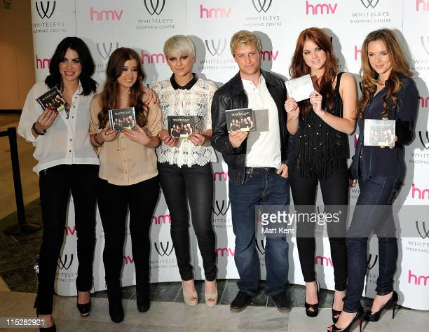 Sharon Condon Leigh Learmont Kasey Smith Kian Egan Corrina Durran and Jodi Albert of Wonderlandd pose after their performance at HMV Bayswater on...