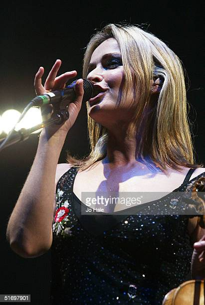 Sharon Corr of The Corrs performs on stage at Wembley Arena on November 8 2004 in London The concert promotes their new album 'Borrowed Heaven'...