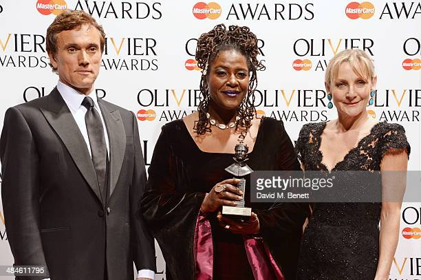 Sharon D Clarke winner of Best Actress in a Supporting Role for 'The Amen Corner' poses with presenters Ben Miles and Lesley Sharp in the press room...