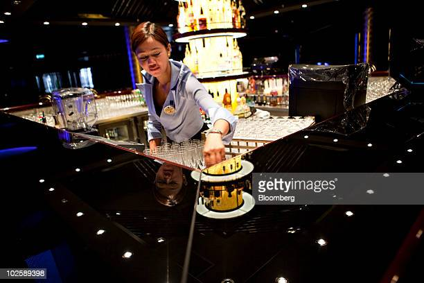 Sharon Durante sets up glasses behind the bar at the Bliss Ultra Lounge aboard the Norwegian Cruise Line's Norwegian Epic ship as it sits docked at...