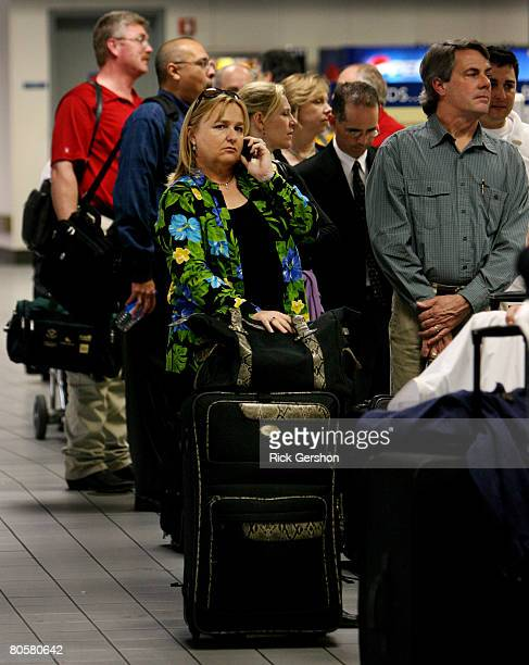 Sharon Garfield waits in line after her American Airlines flight to Denver was canceled twice April 9 2008 at the Dallas Fort Worth International...