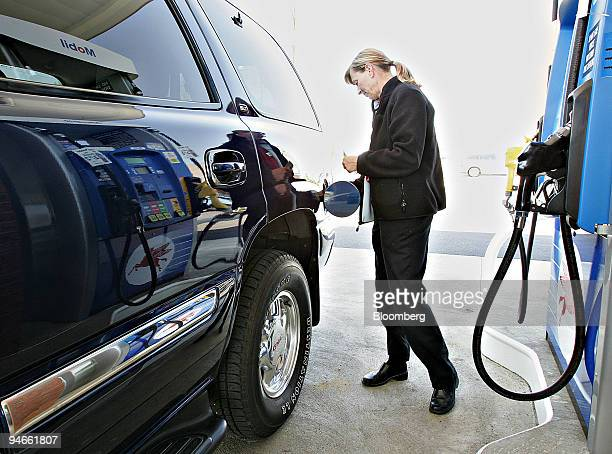 Sharon Hardin of Hamilton Ohio tops off her gas tank at an Exxon Mobil gas station in Hamilton Ohio Thursday April 27 2006
